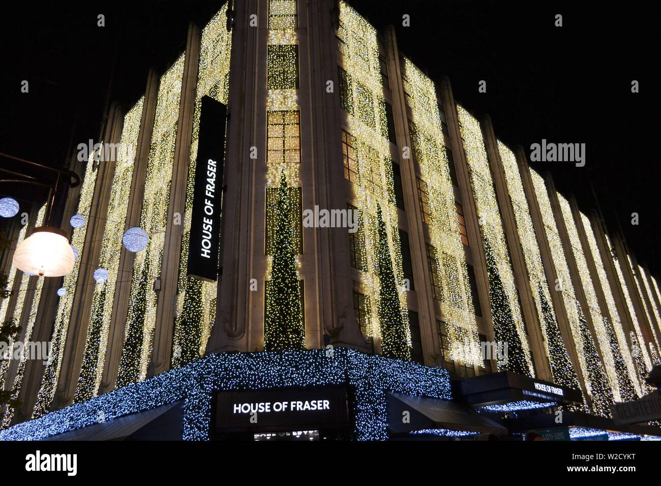 London/UK - November 28, 2013: Garlands of thousands of LED lights decorate the House of Fraser superstore during Christmas night hours. Stock Photo