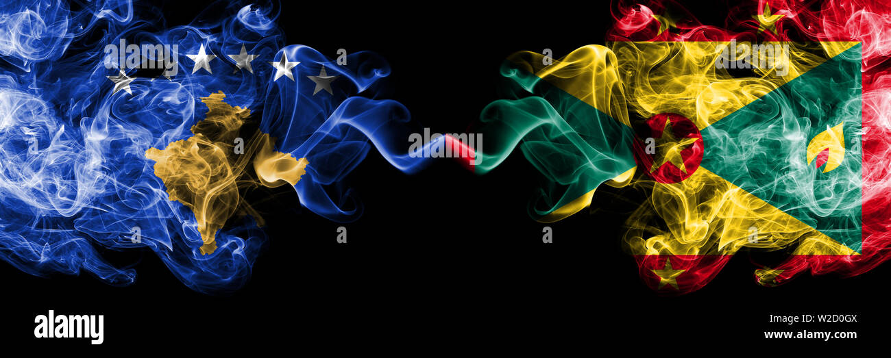 Kosovo vs Grenada smoky mystic flags placed side by side. Thick colored silky smokes combination of Kosovo and Grenada flag Stock Photo