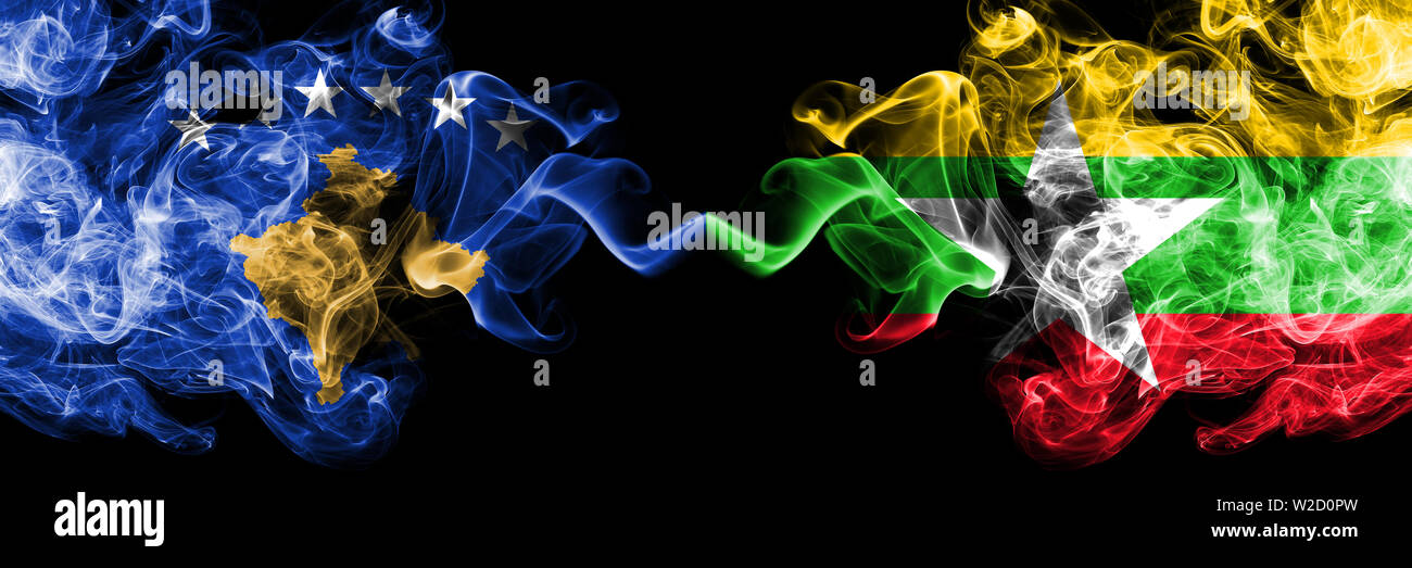 Kosovo vs Myanmar smoky mystic flags placed side by side. Thick colored silky smokes combination of Kosovo and Myanmar flag Stock Photo