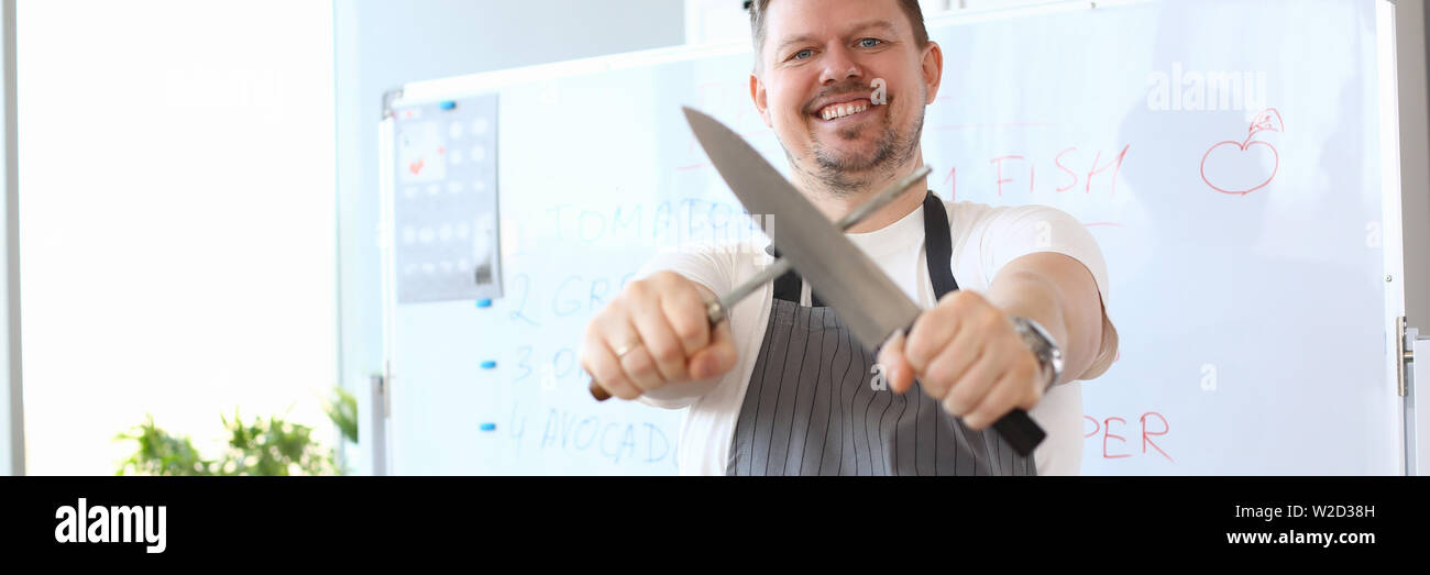Blogger Chef Sharpening Steel Knife Photography - Stock Image
