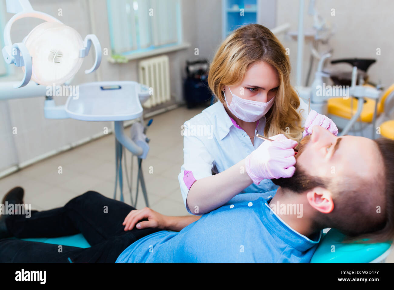 Young professional doctor dentist in a modern office with dental
