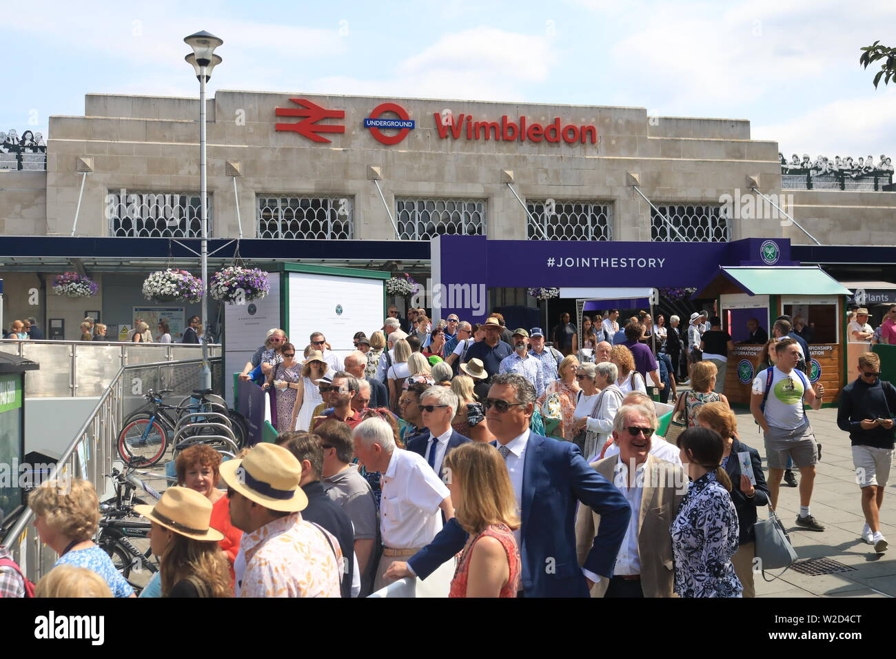 Wimbledon, London. UK. 8th July 2019. Large crowds arrive at Wimbledon station to attend the matches at the All Enngland Tennis Club  on the second Monday which is also referred to as Manic Monday as it is the busiest day of the Wimbledon Championships with the last 16 matches taking place  for  men's and Ladies 's singles of the tennis tournament . Credit: amer ghazzal/Alamy Live News Stock Photo