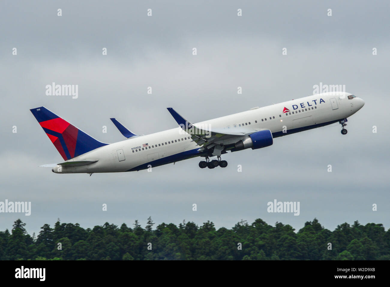 Tokyo, Japan - Jul 4, 2019. Delta Air Lines N198DN (Boeing 767-300ER) taking-off from Narita Airport (NRT). - Stock Image