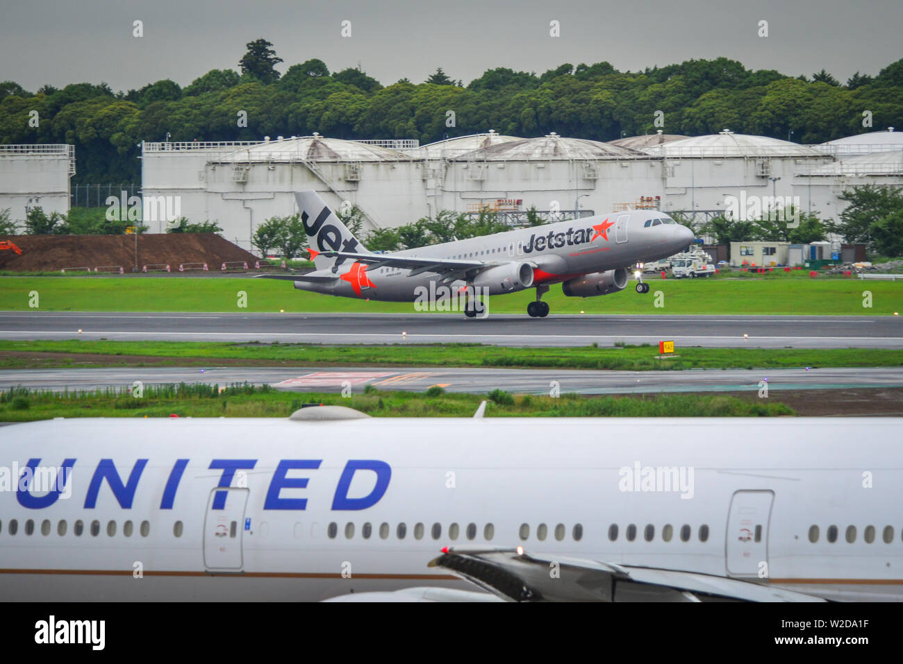 Tokyo, Japan - Jul 4, 2019. Passenger airplanes at Narita Airport (NRT). Narita serves more than 40 million passengers in 2018. - Stock Image