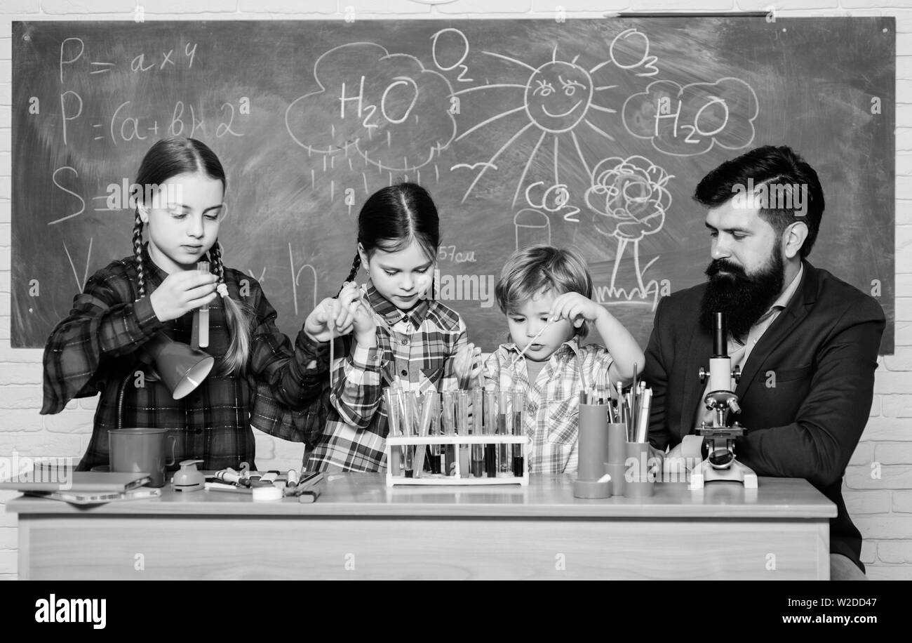 kids in lab coat learning chemistry in school laboratory. chemistry lab. happy children teacher. back to school. making experiment in lab or chemical cabinet. Research and development. - Stock Image