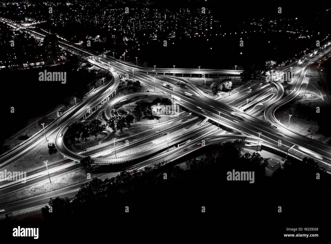 City interchange closeup at night , beautiful transport infrastructure background. Black and White. Aerial view - Stock Image