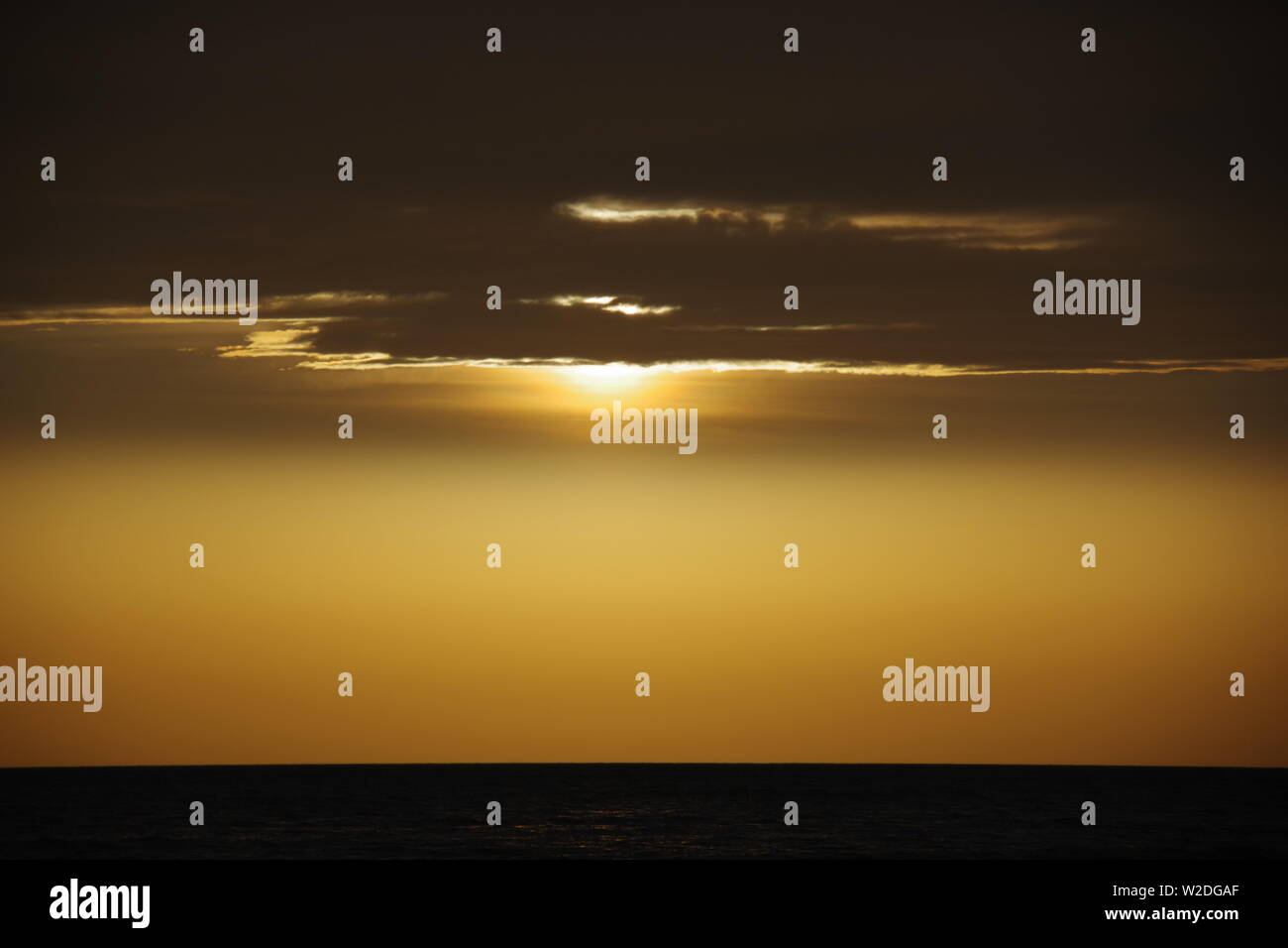 Golden Winters Sunrise with Gloomy Stratus Cloud. Aberdeen, Scotland, UK. Stock Photo