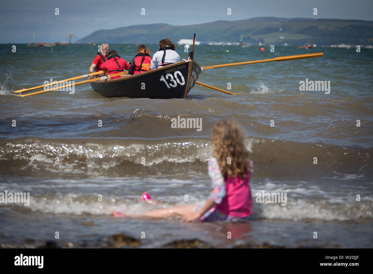 Stranraer, Scotland, UK. 7 July 2019. Competitors from around the country, and internationally, participate in the opening ceremonies of the Skiffieworlds 2019, which runs from 7th-13th July. Skiffieworlds is the World Championship for the St Ayles Skiff class of coastal rowing boat. The Championships are held every three years. Credit: Jeremy Sutton-Hibbert/ Alamy Live News - Stock Image