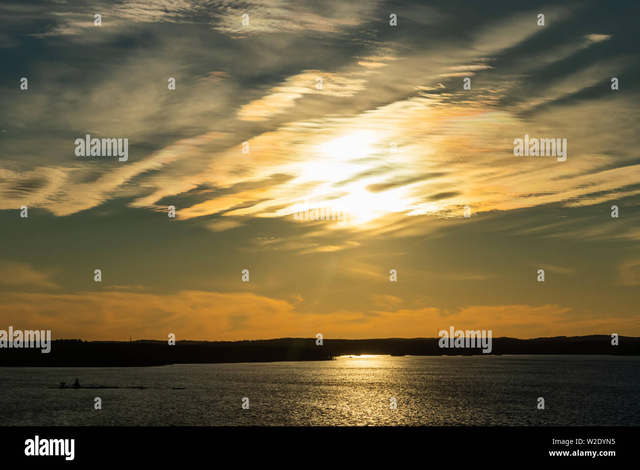 Beautiful sunset with clouds over lake Nasijarvi in Tampere, Finland - Stock Image