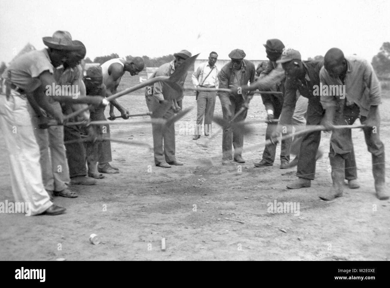 African American convicts working with shovels, possibly the