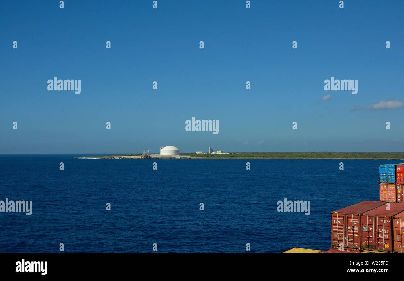 caucedo, dominican republic - february 24, 2014: view onto aes andres liquefied natural gas terminal und power station from an inbound containership - Stock Image