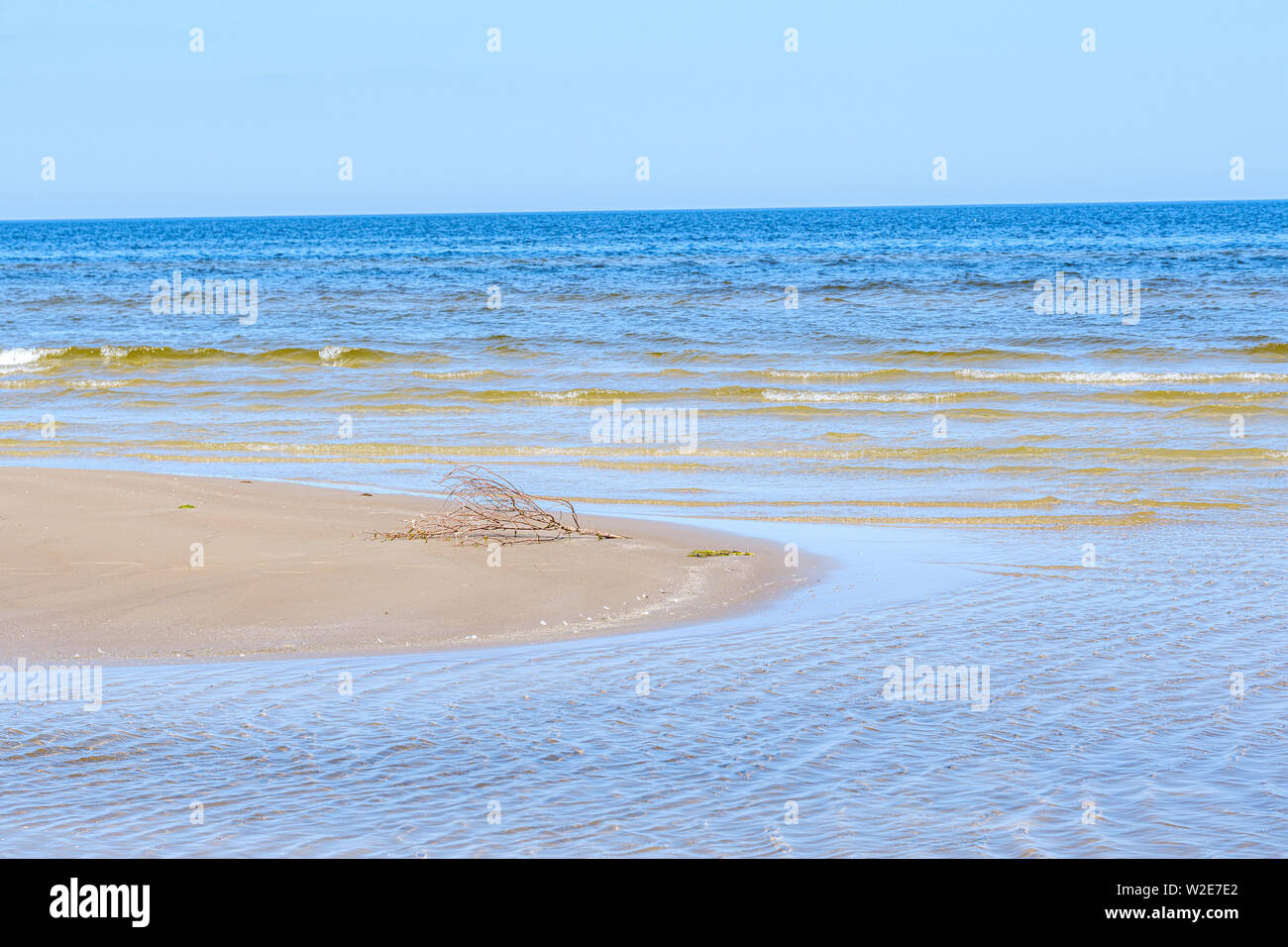 sea beach with blu sky and waves in summer sand Stock Photo