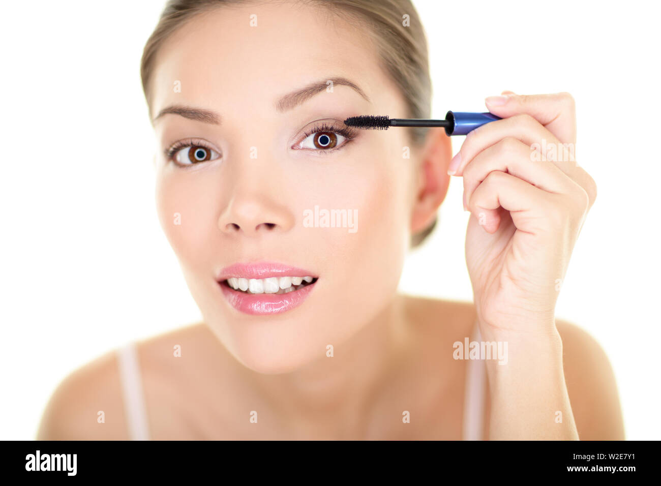 Beauty makeup woman putting mascara eye make up on eyes