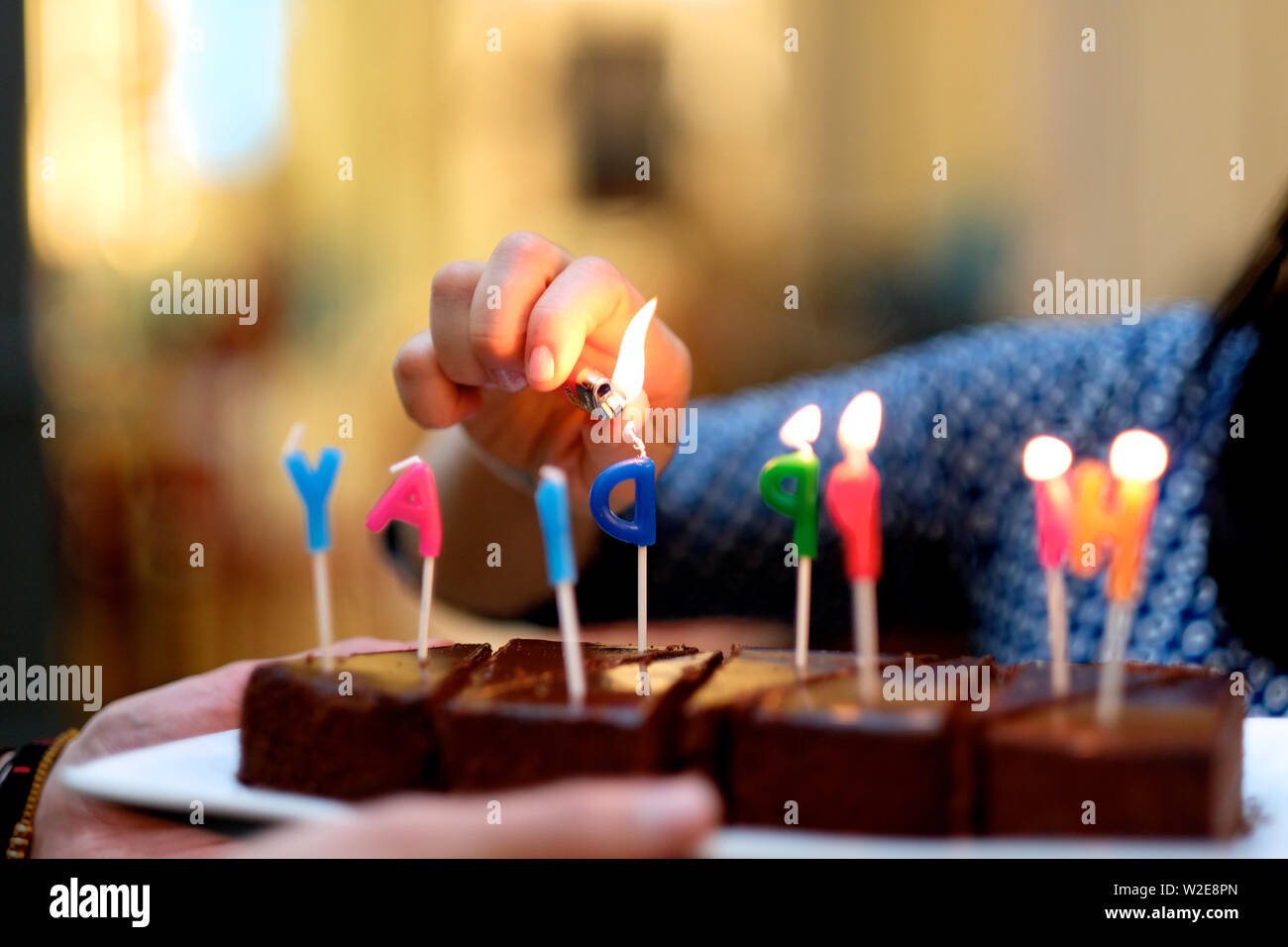 The girl is preparing for the holiday, decorating cakes. - Stock Image