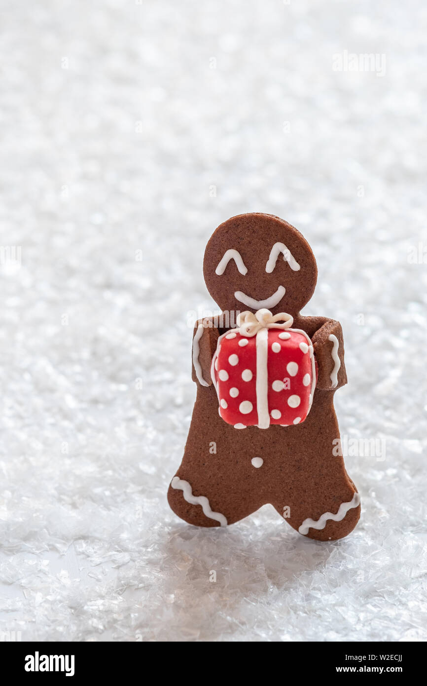 Gingerbread cookie men with tiny marzipan snowman Stock Photo