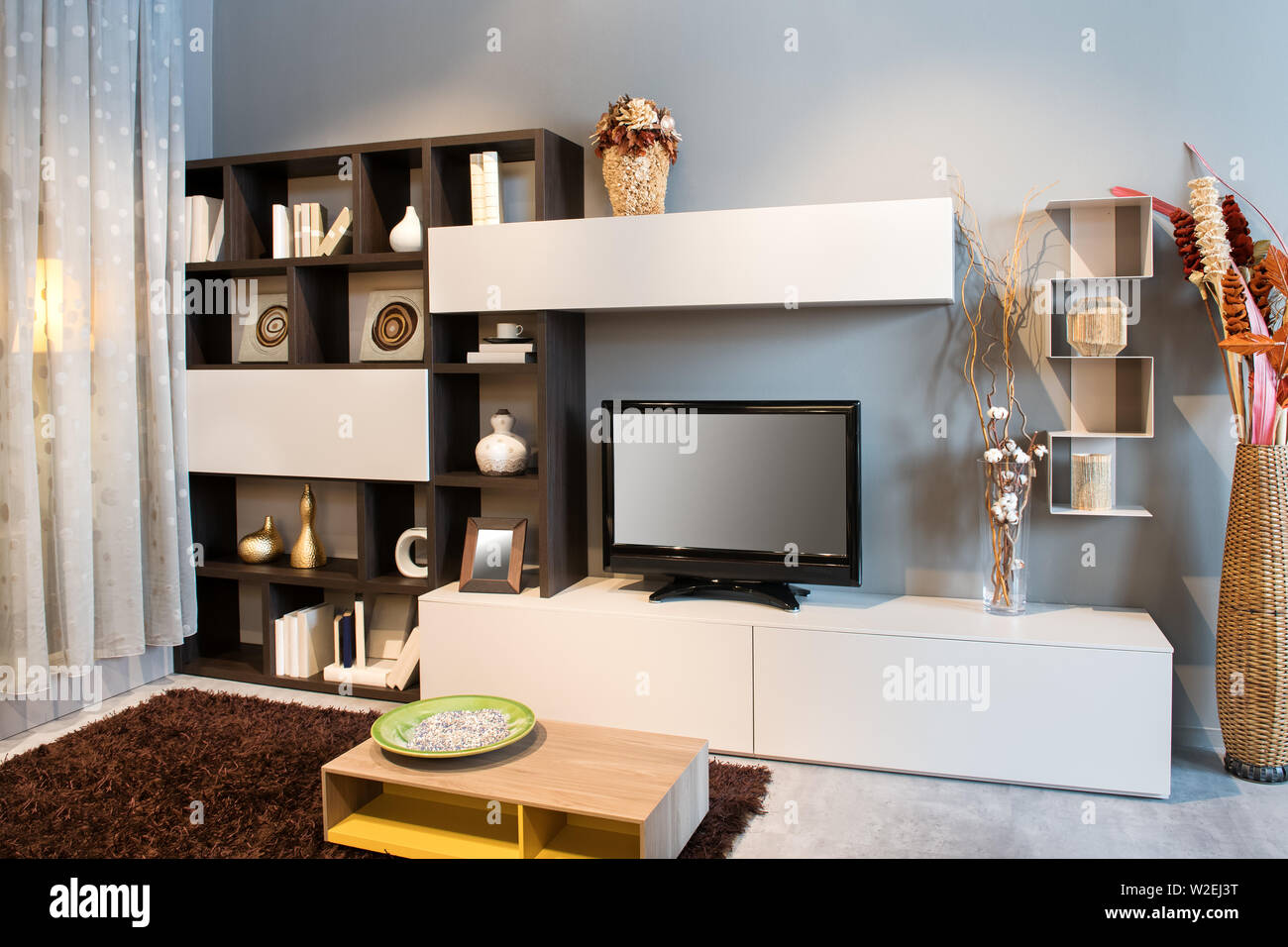 . Modern living room or den interior with TV on a small wall unit with