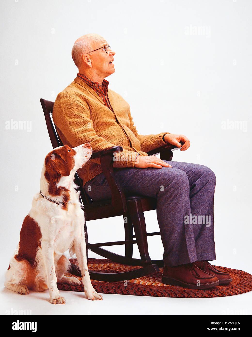 Wondrous Senior Male Sitting In A Rocking Chair With A Dog Next To Frankydiablos Diy Chair Ideas Frankydiabloscom
