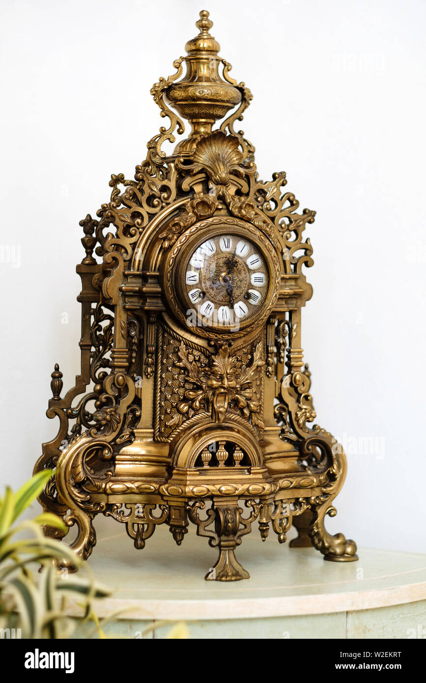 Antique mechanical clock made of metal - Stock Image
