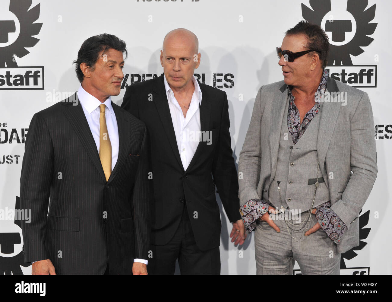 LOS ANGELES, CA. August 03, 2010: Sylvester Stallone (left), Bruce Willis & Mickey Rourke at the world premiere of their new movie 'The Expendables' at Grauman's Chinese Theatre, Hollywood. © 2010 Paul Smith / Featureflash - Stock Image