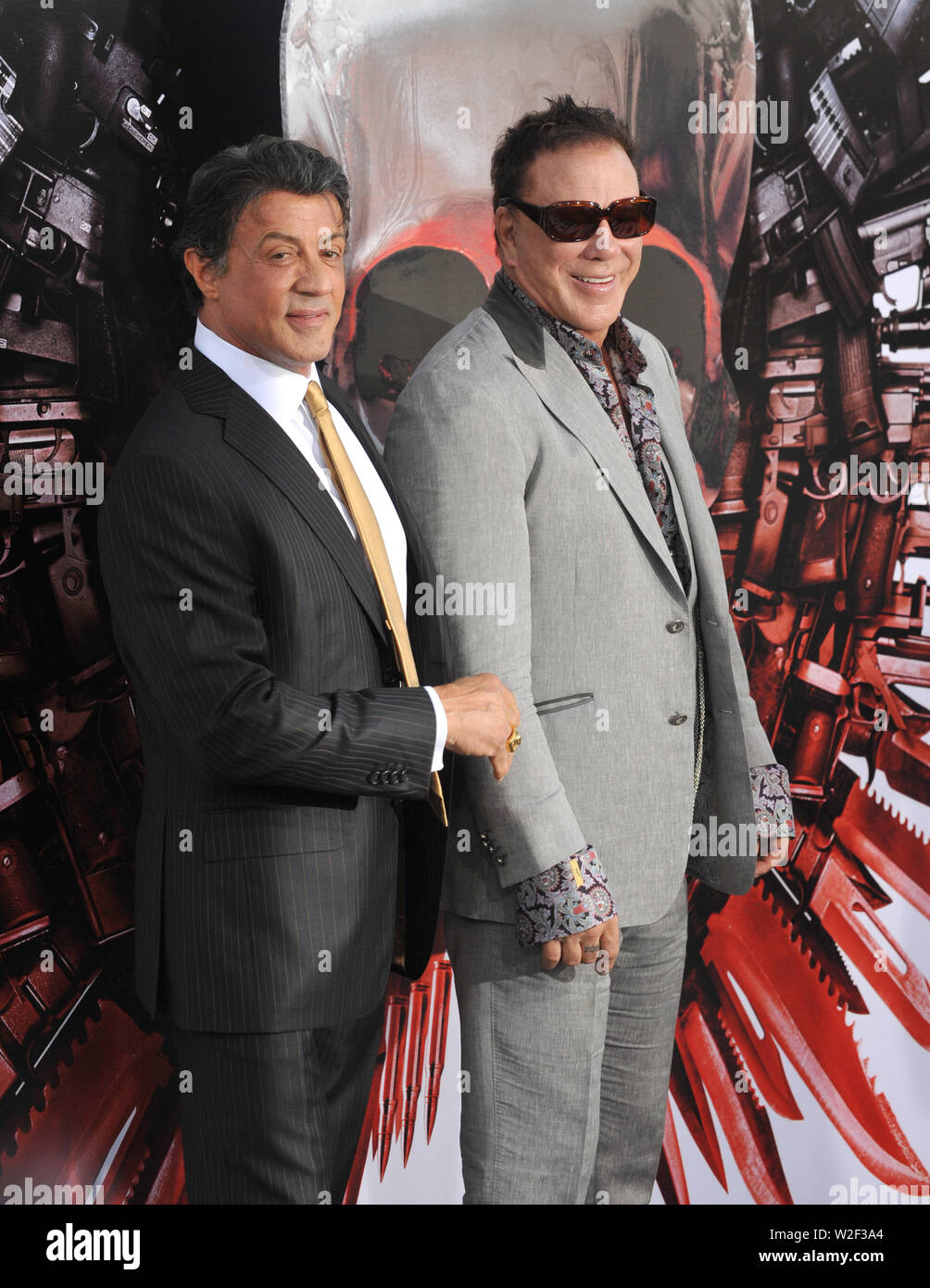 LOS ANGELES, CA. August 03, 2010: Sylvester Stallone (left) & Mickey Rourke at the world premiere of their new movie 'The Expendables' at Grauman's Chinese Theatre, Hollywood. © 2010 Paul Smith / Featureflash - Stock Image