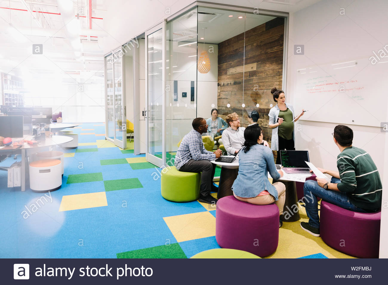 Compute programmers meeting in creative open plan office Stock Photo