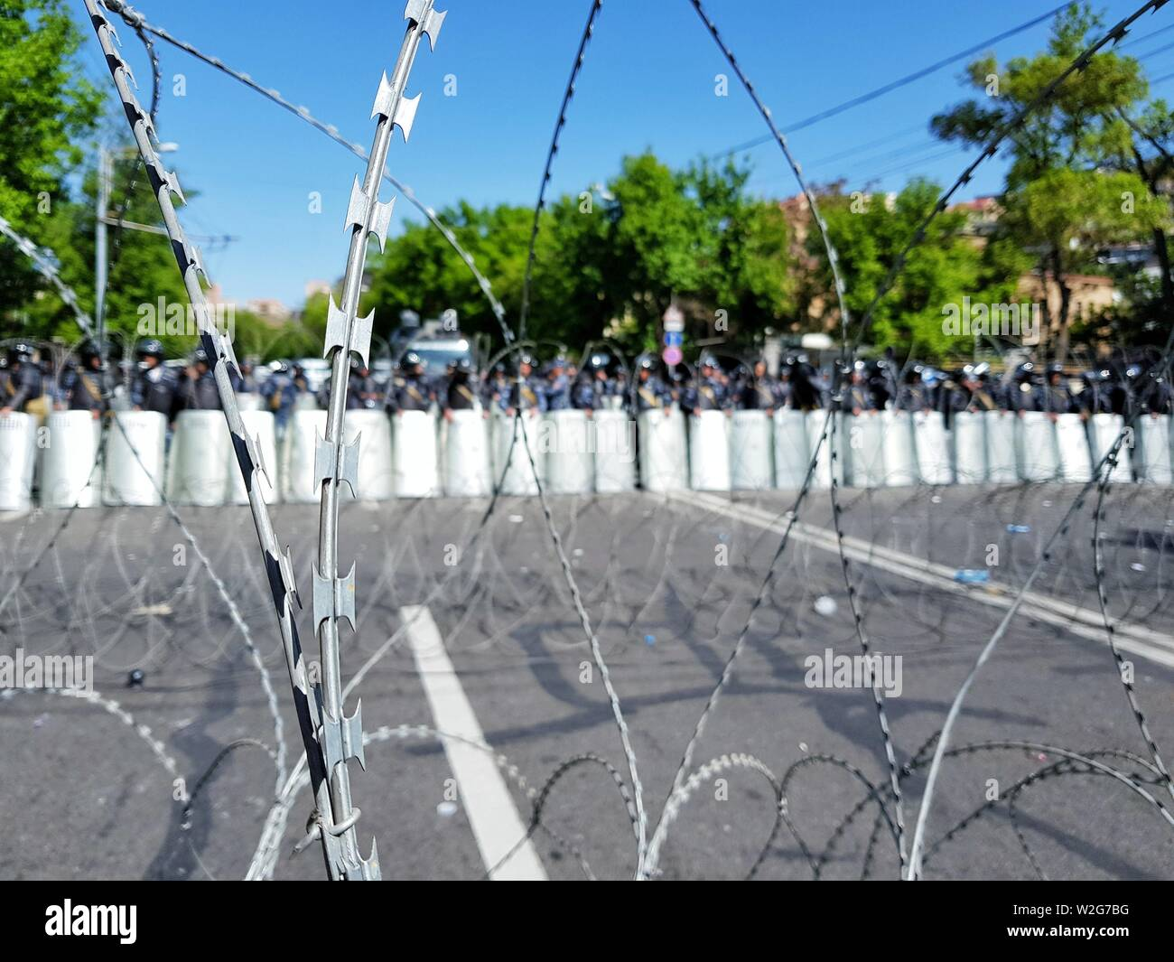 A barbed wire fence set up by police during a riot - Stock Image