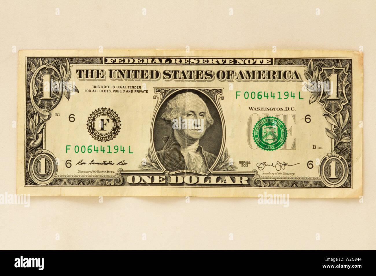 One dollar bill on white background. Stock Photo
