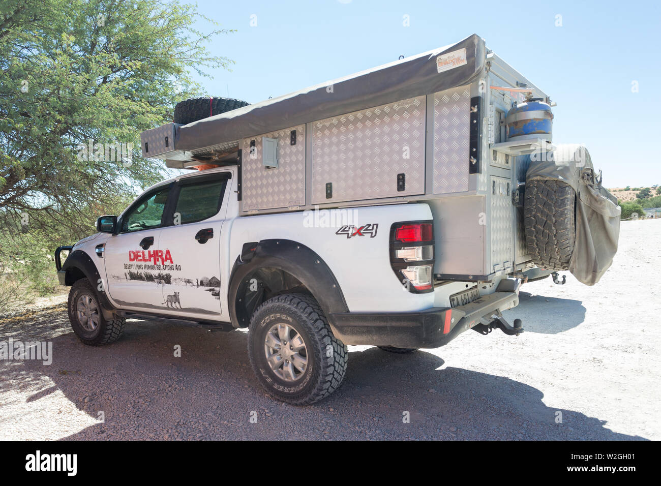 4x4 overland off road vehicle or truck with text DELHRA desert lions human relations aid, a non profit organisation dealing in human animal conflict Stock Photo