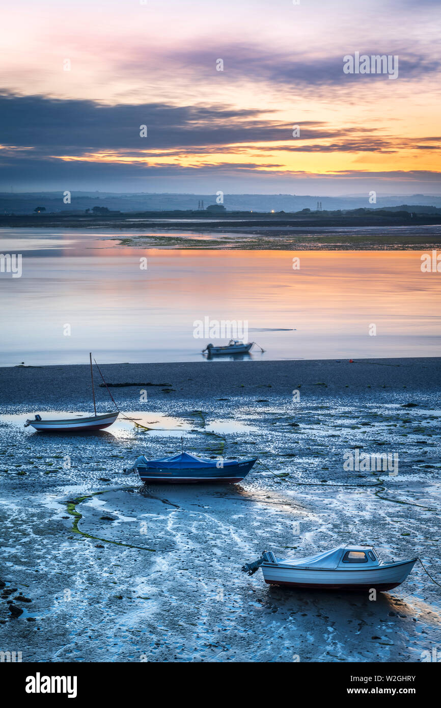 Appledore, North Devon, England. 9th July 2019. UK Weather. At first light the cooler blue tones of the River Torrige estuary contrast with the warmer colours of the dawn sky over the  little North Devon coastal village of Appledore,  as the weather is forecast to remain dry with light cloud and  light winds in the South West of England. Credit: Terry Mathews/Alamy Live News - Stock Image