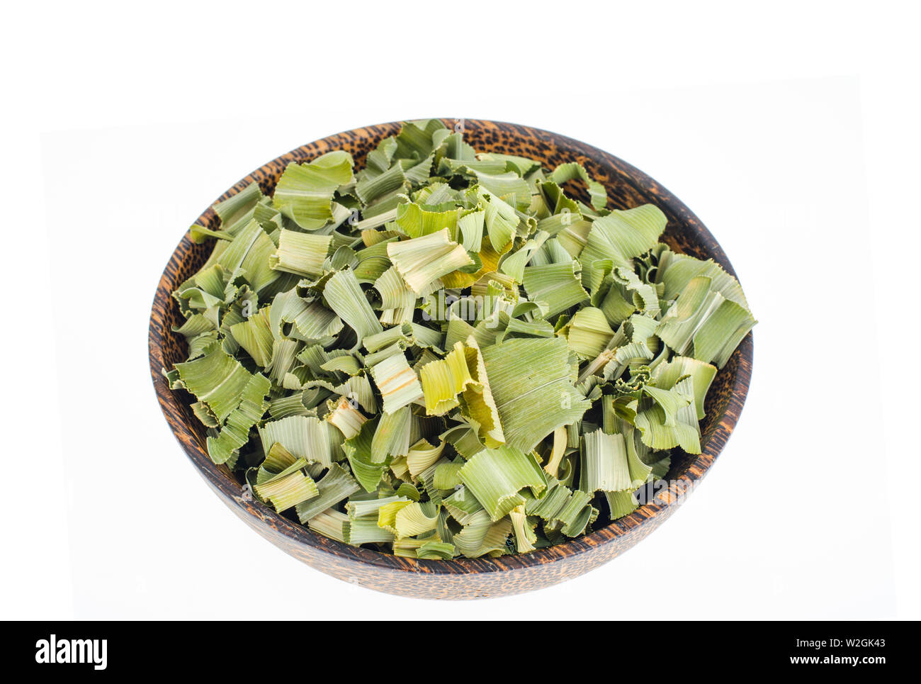 Dried pandan leaves in wooden bowl.  - Stock Image