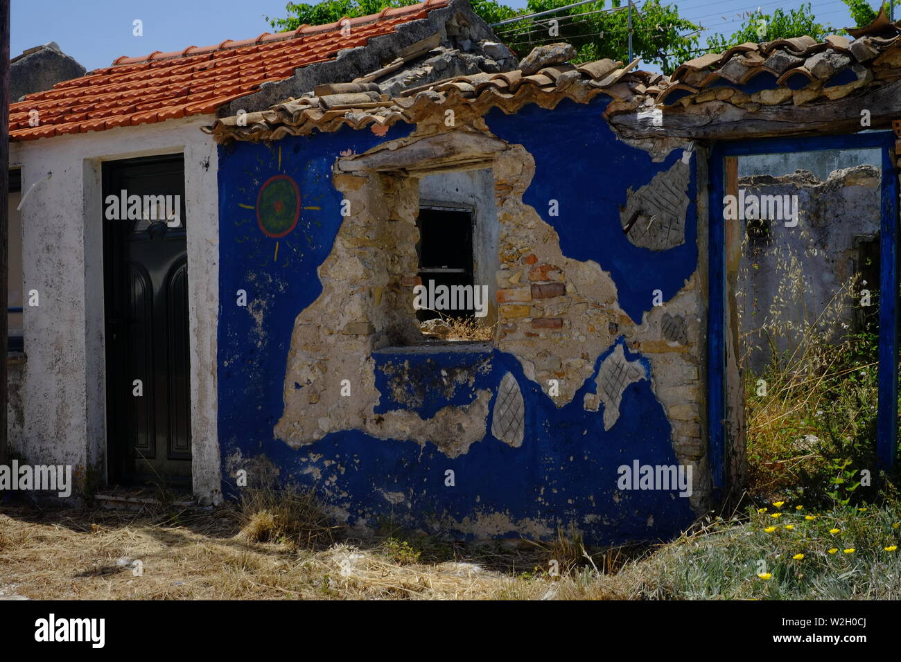 Artistic designed blue graffiti on an old/new house situated in Afionis Corfu - Stock Image