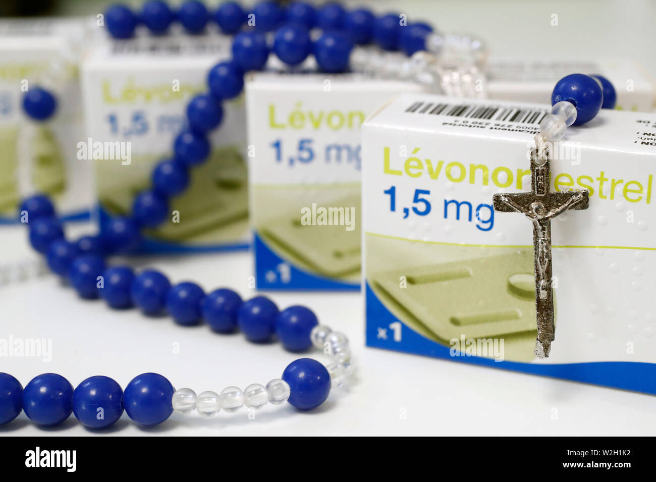 Rosary and Levonorgestrel an hormonal medication which is used in a number of birth control methods.  France. - Stock Image