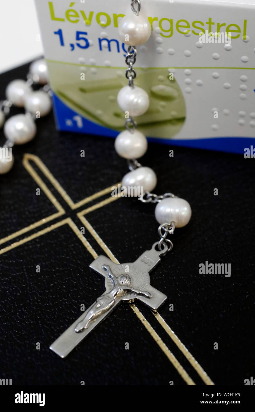 Rosary , bible and Levonorgestrel an hormonal medication which is used in a number of birth control methods.  France. - Stock Image