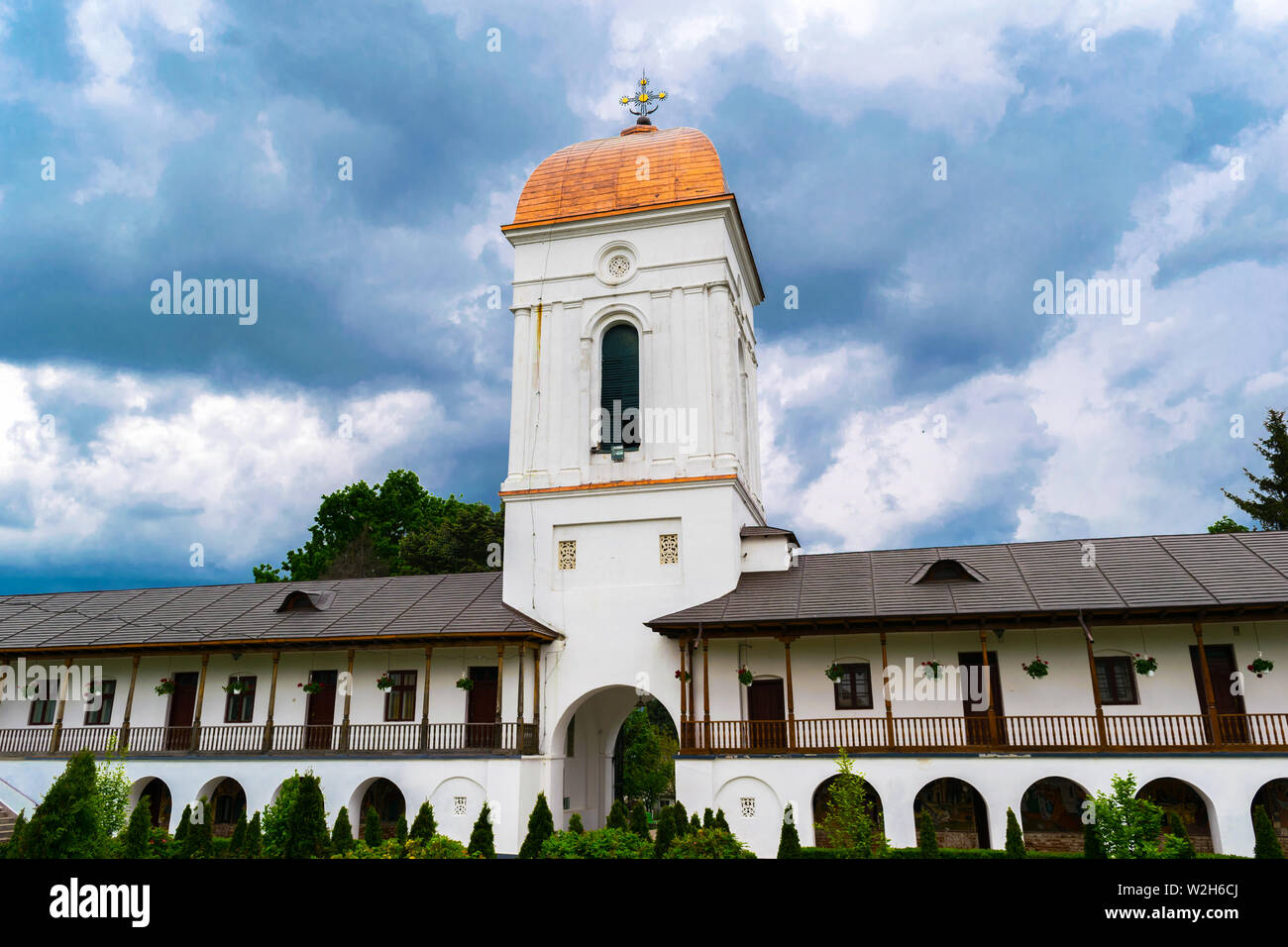 Ilfov, near Bucharest, Romania - April 30, 2019: Entrance to orthodox Cernica Monastery courtyard showing the bell tower building. Stock Photo