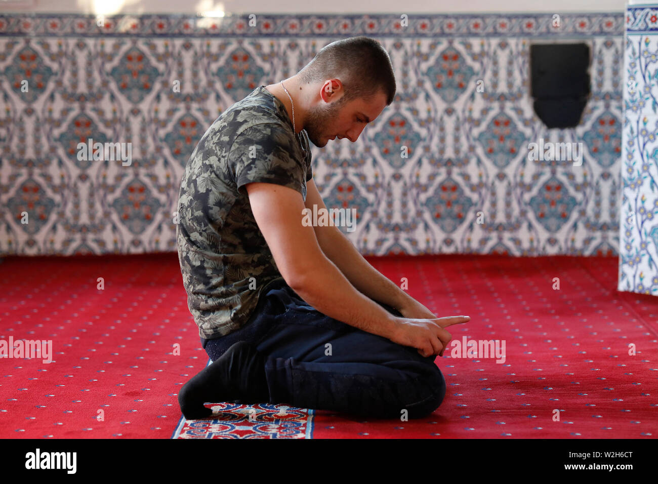 Young Kosovar praying in a Prizren mosque, Kosovo. Stock Photo