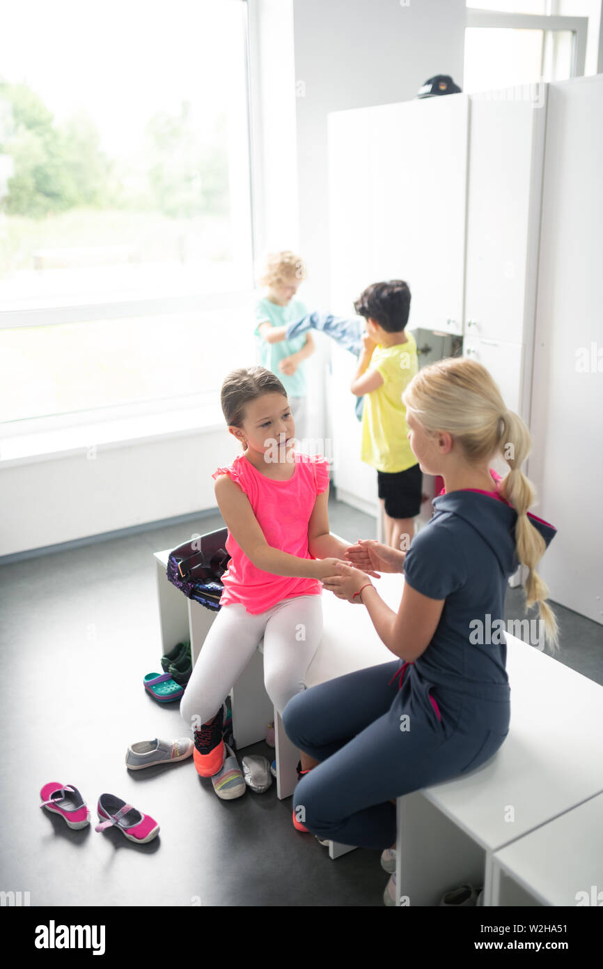 School children playing in a changing room. - Stock Image