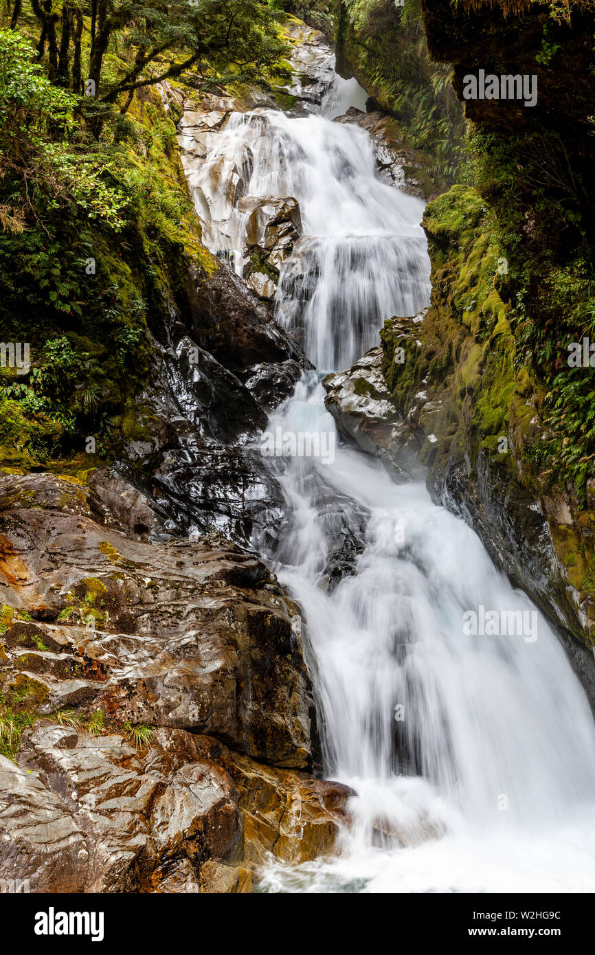 A Waterfall On The Milford Road Fiordland National Park