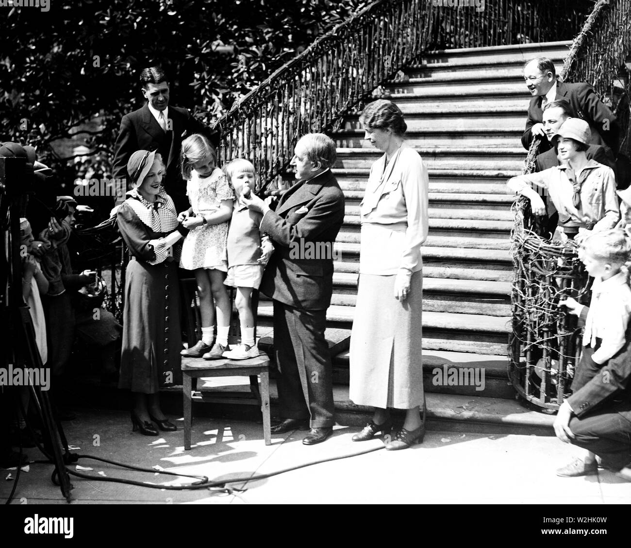 So that's where eggs come from, and howard thurston, professional magician, pulls an easter egg from the mouth of buzzie dall at the white house egg rolling festivals. The group, from the left: jane thurston, daughter of the magician; sistie dall and buzzie, grandchildren of the president; mr. Thurston; and mrs. Roosevelt ca. 1934 Stock Photo