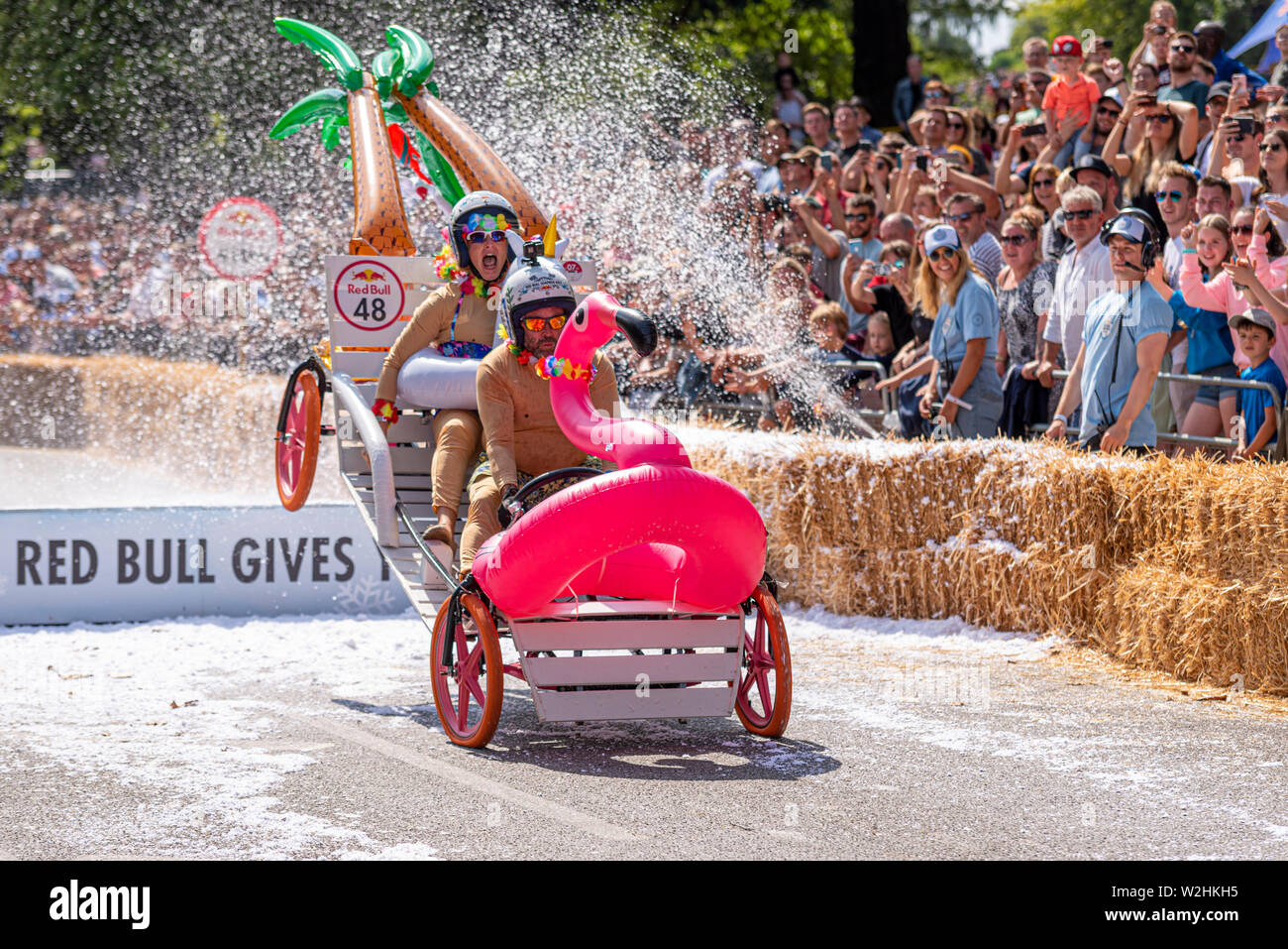 The Honeymooners competing in the Red Bull Soapbox Race 2019 at Alexandra Park, London, UK. Jumping over ramp with people - Stock Image
