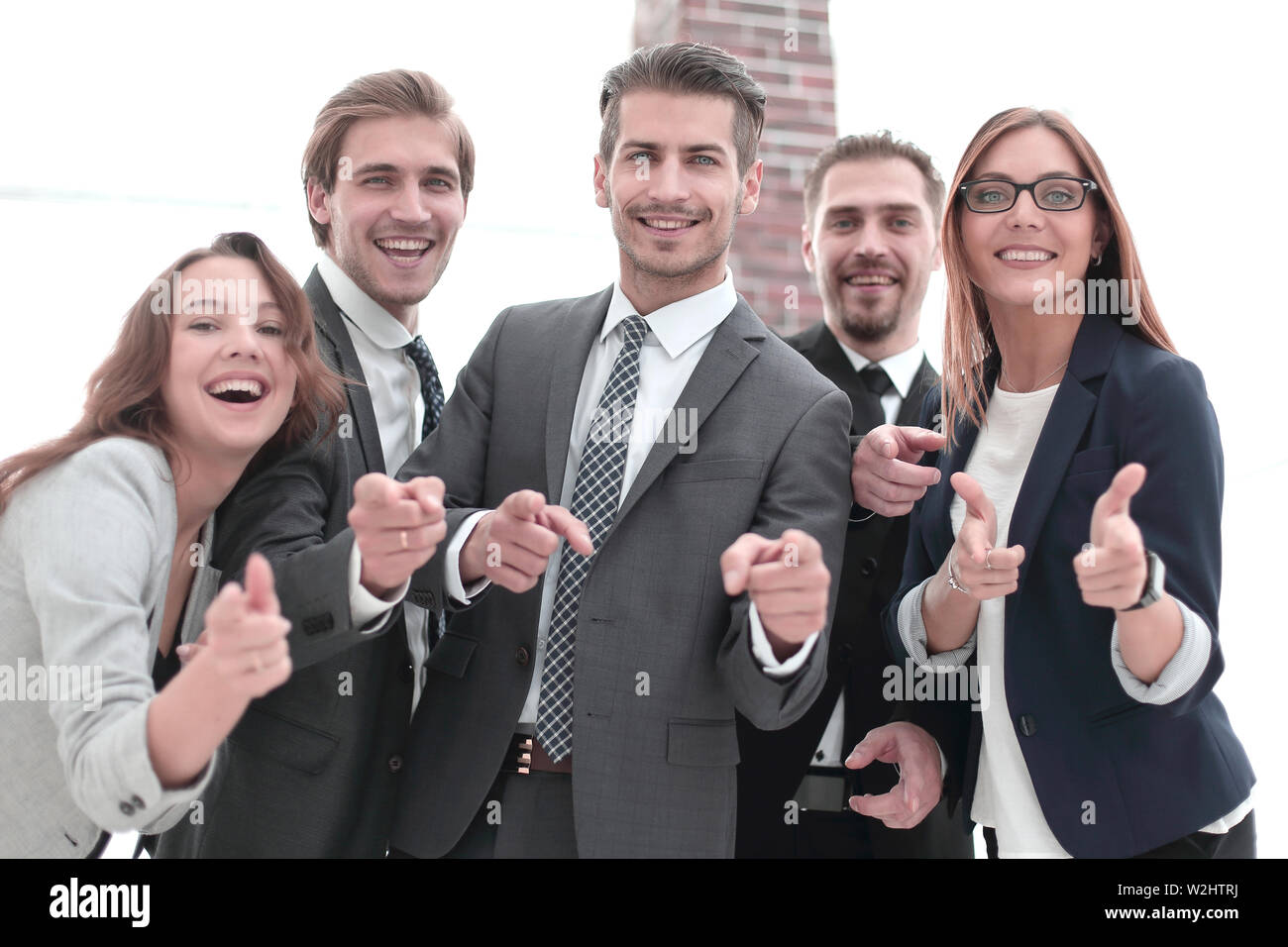 A group of business people standing and pointing at you - Stock Image