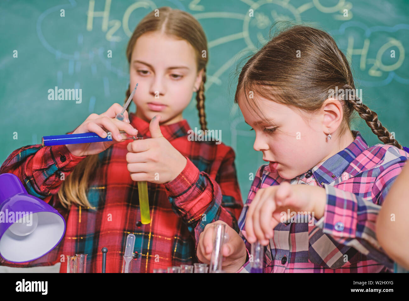 School classes. Kids adorable friends having fun in school. School chemistry lab concept. Practicum based teacher professional development program. Practical knowledge. Child care and development. - Stock Image