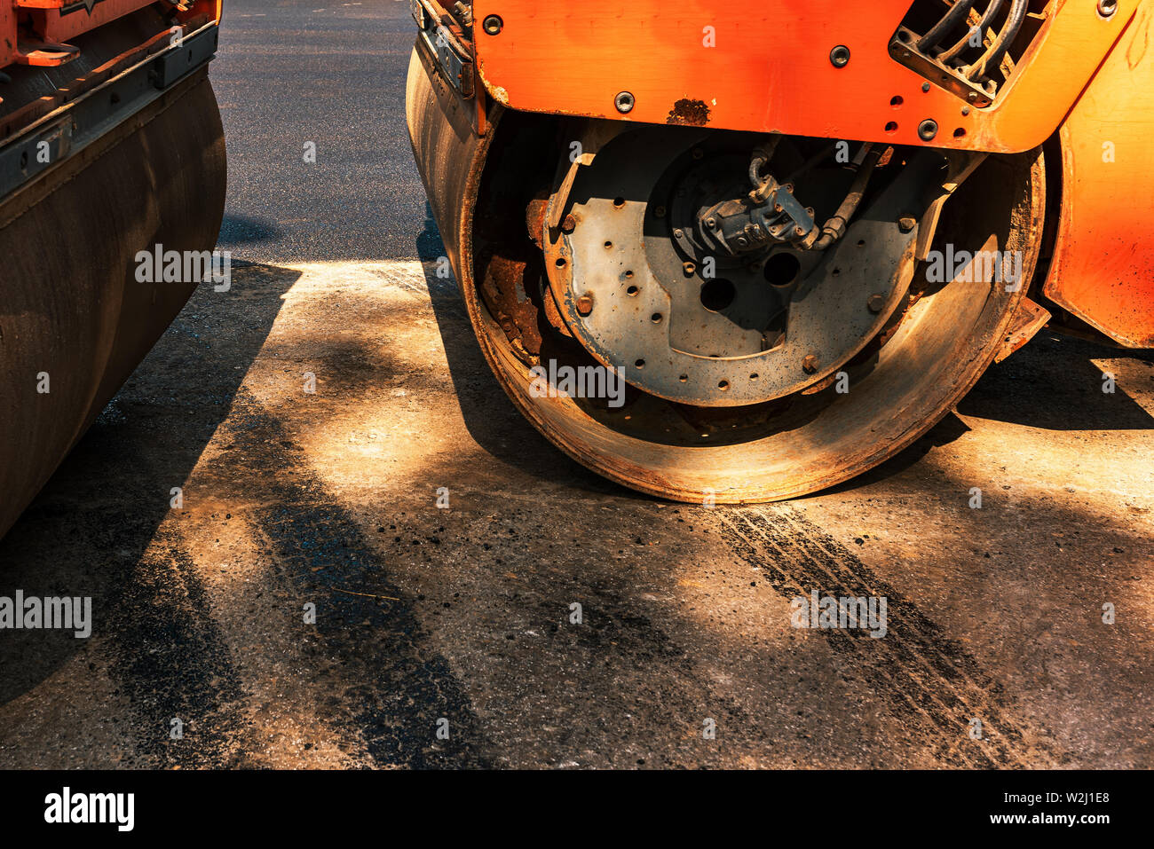 Asphalt road roller construction industry machine detail close up with selective focus - Stock Image