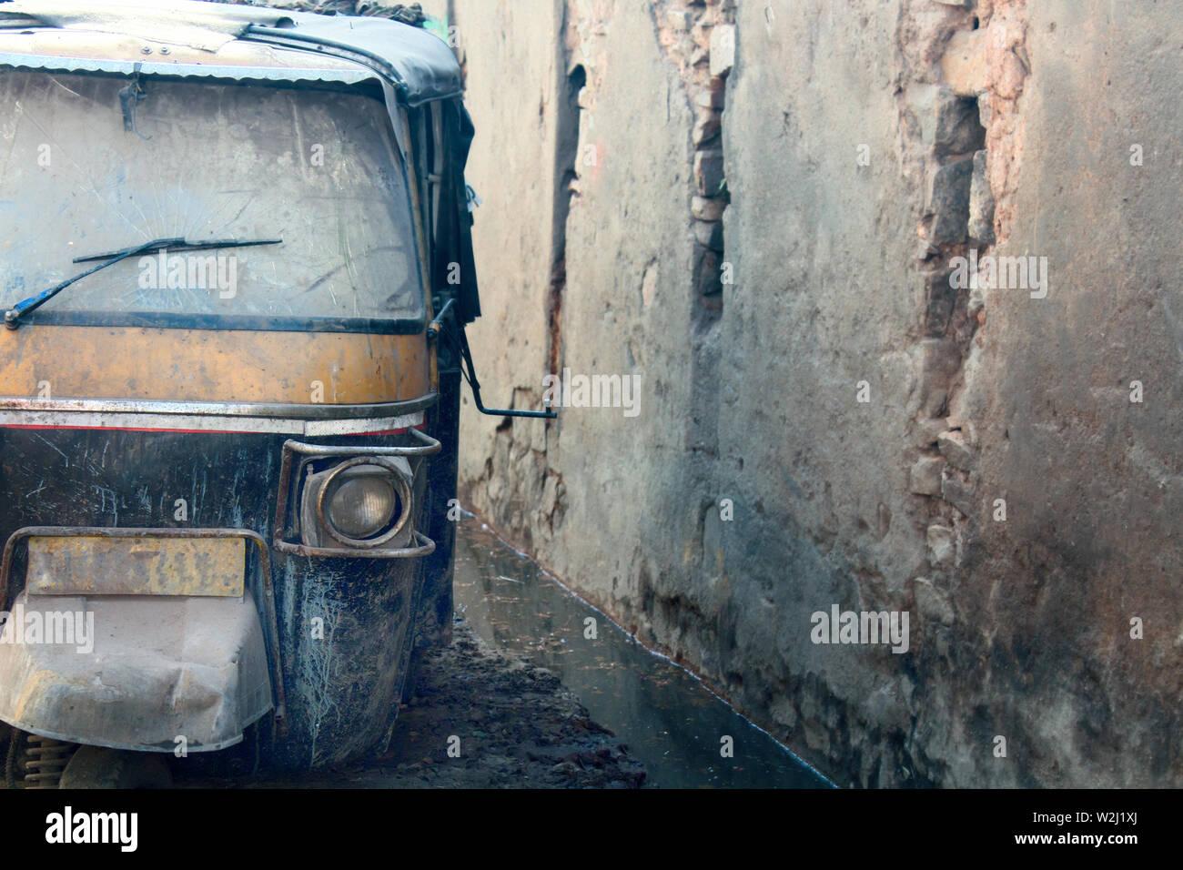 old abandoned ricksha taxi tuk tuk. used non-working vehicles. - Stock Image