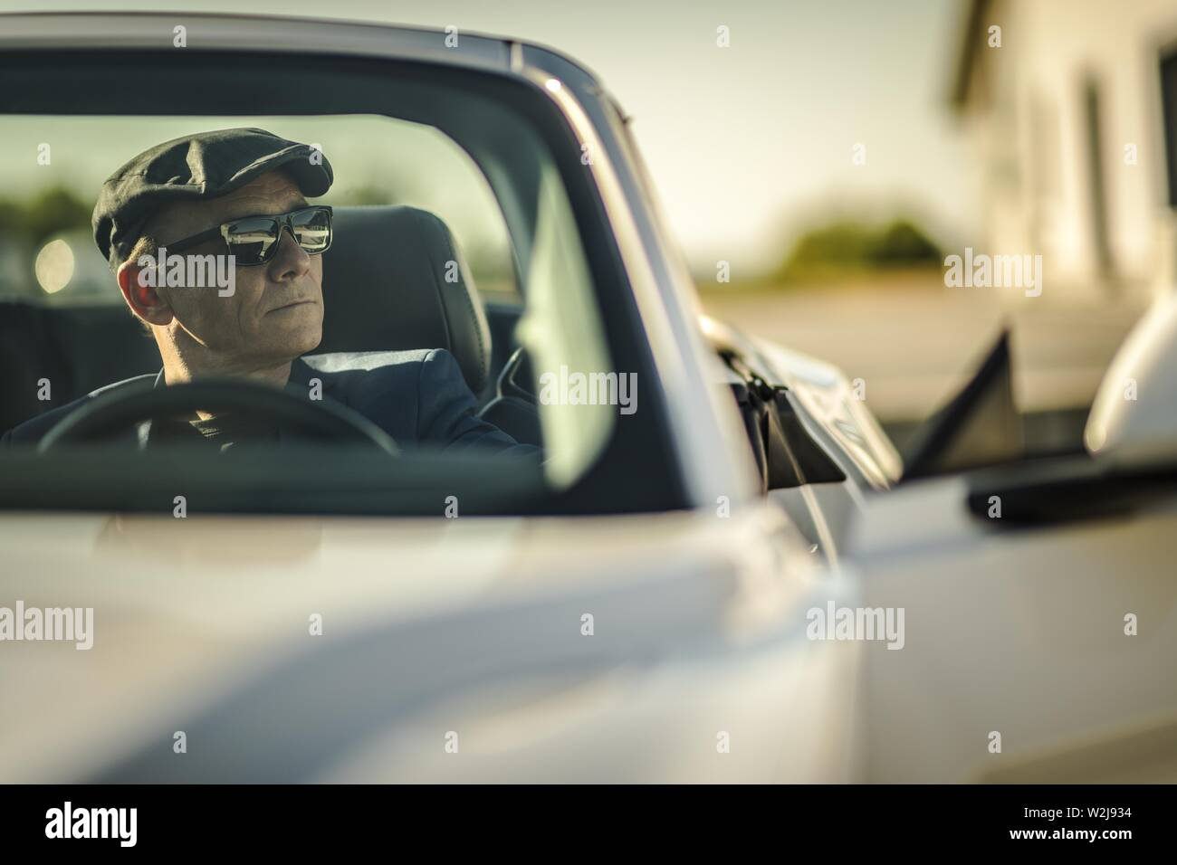 Attractive Elegant Caucasian Men in His 60s Inside Sporty Convertible Car. Midlife Crisis Conceptual Photo. Stock Photo
