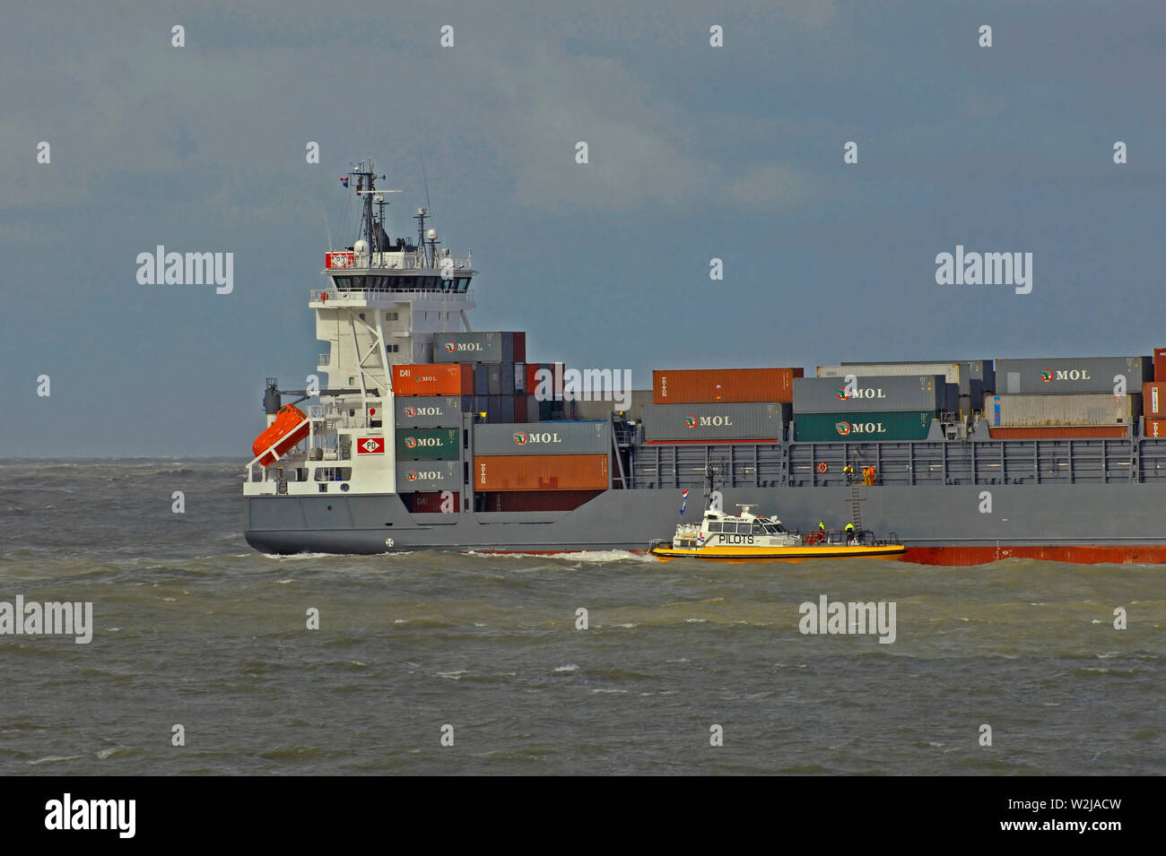 port of rotterdam, zuid holland/netherlands - march 21, 2007: the pilot boarding the inbound containership  annabella (imo 9354363) from pilot launch - Stock Image