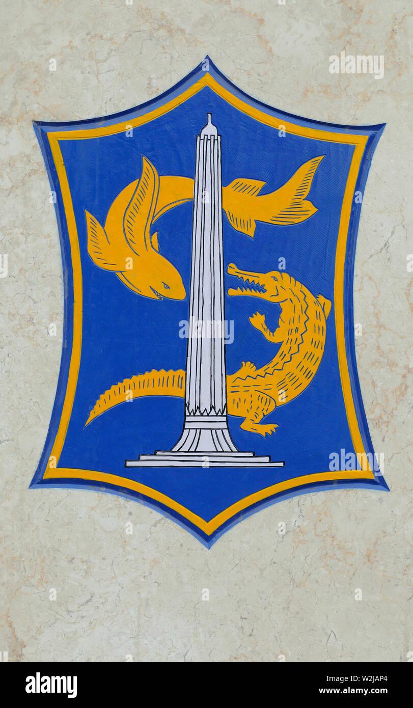 surabaya, jawa timur / indonesia - november 11, 2009: coat of arms of the city of surabaya at a wall on  jalan kebalen timur - Stock Image