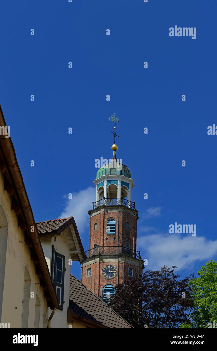 leer, niedersachsen/germany - june 05, 2013: view onto the steeple of grosse kirche ( large church ) and top facades of historical warehouses - Stock Image