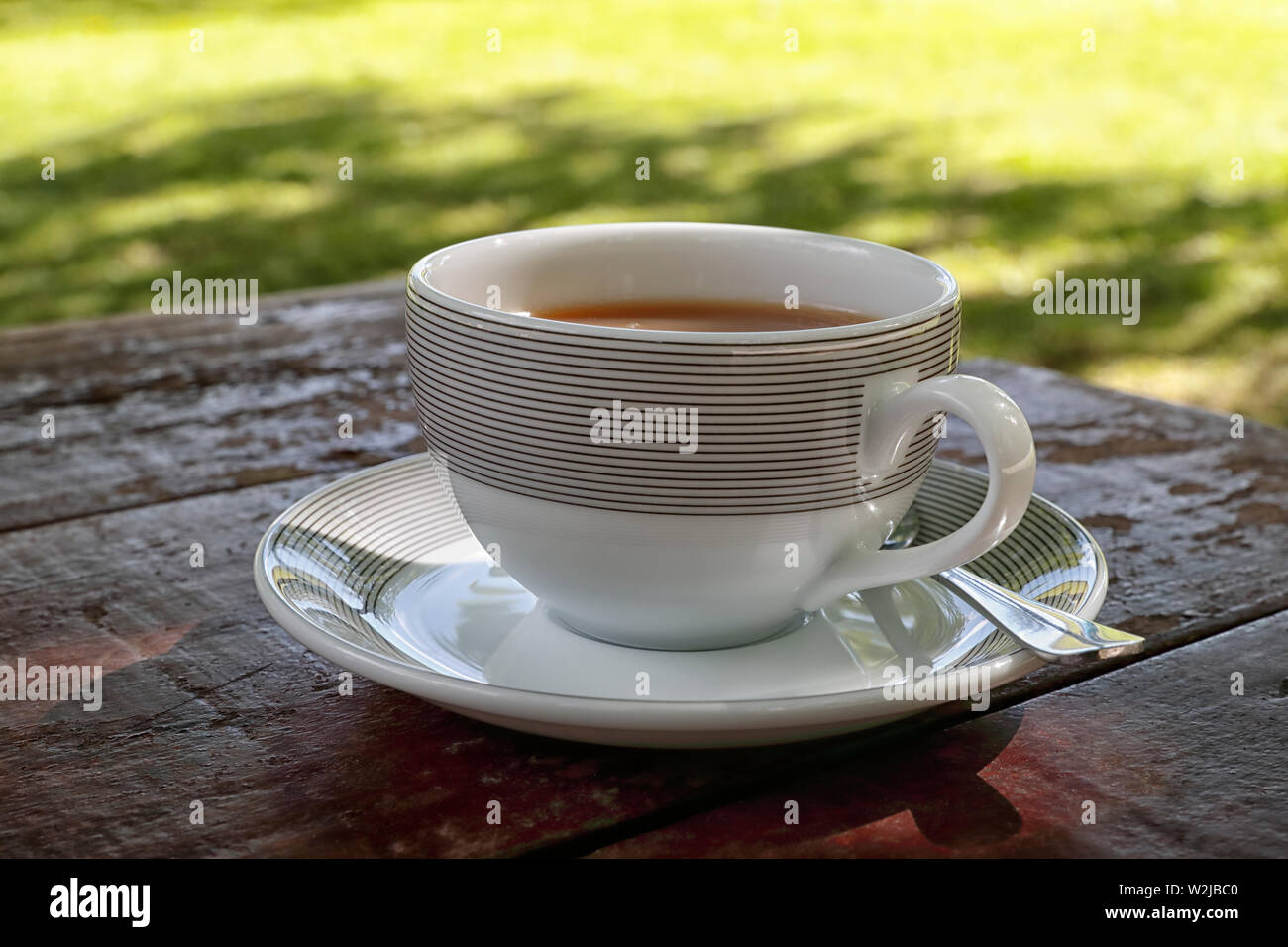 A nice refreshing cup of tea outdoors in summer - Stock Image