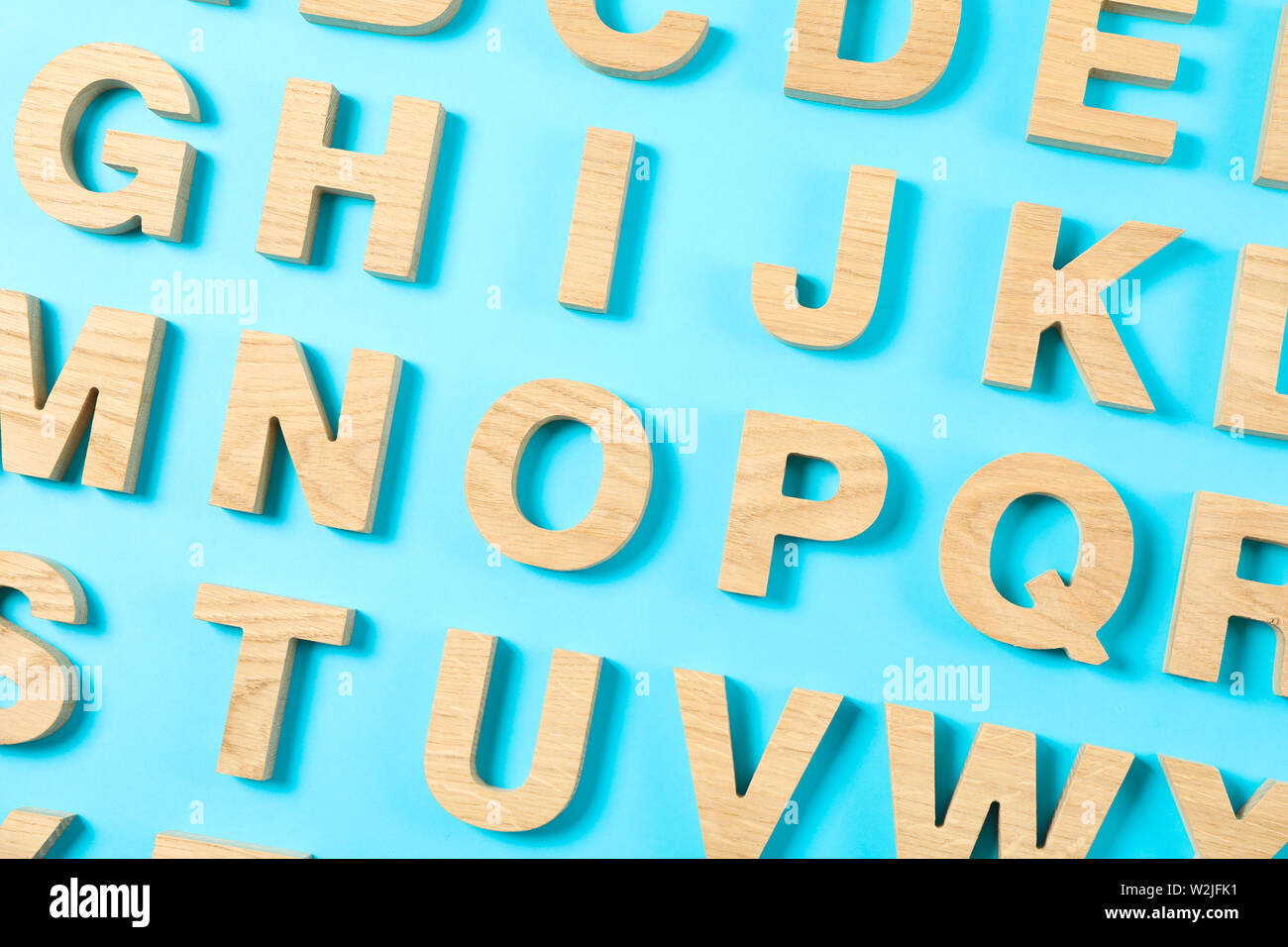 Wooden Letters Of English Alphabet On Color Background Stock Photo