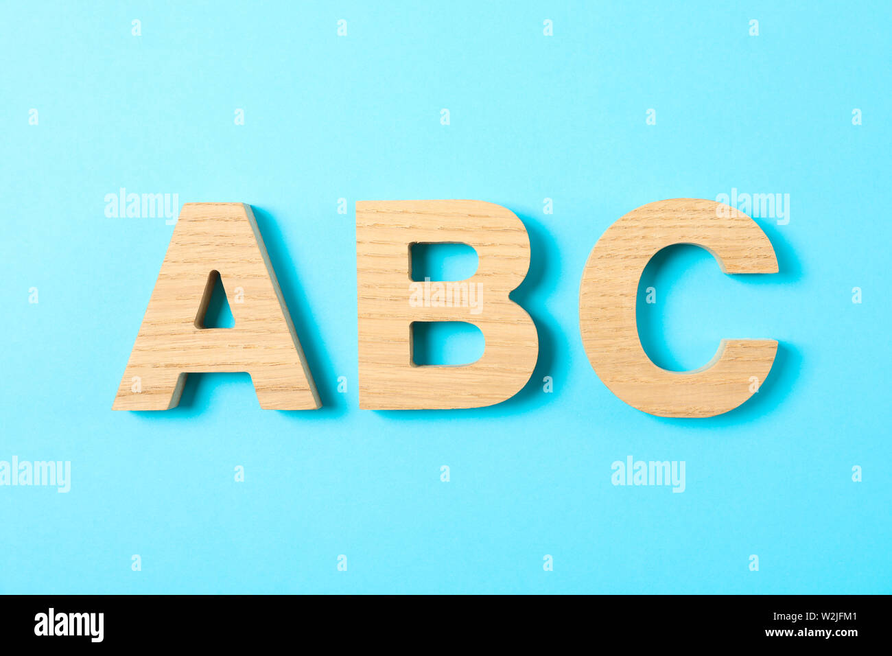 Wooden Letters Of English Alphabet On Color Background Space For